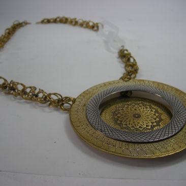 Riveted Medallion. Glass, chain making, spacer rivets, etching. Spring 2013.