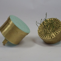Hollow Constructed Rings. Brass, flocking, grass, dirt. One box opens and holds gardening supplies. The other grows the plants. Spring 2013.