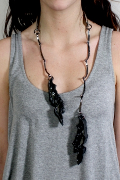 "Using our ""cube"" students create a series. 3d printed plastic, laser cut mirrored acrylic. copper patina chain. Fall 2014."