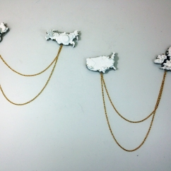 "Using our ""cube"" students create a series. 3d printed plastic, brass chain, fabricated pin backs and settings, patina. Fall 2014."